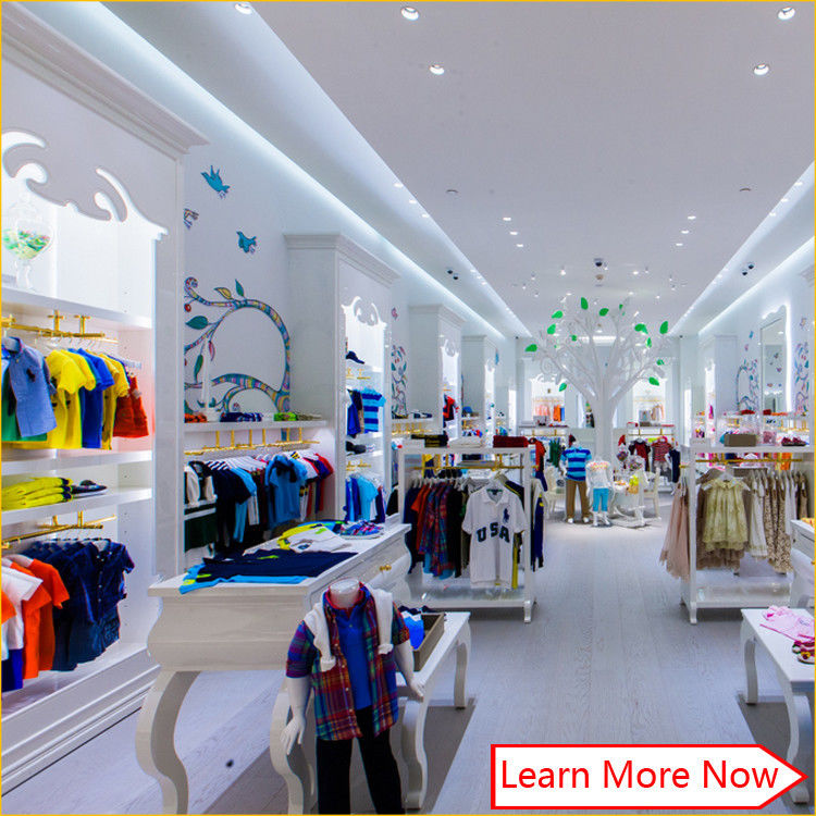Customized nice design fashion white wooden kids clothing store interior design,kids baby shop design decoration proveedor